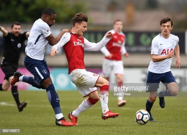 Vlad Dragomir of Arsenal is pulled back by Japhet Tanganga of Tottenham during the match between Arsenal and Tottenham Hotspur at Meadow Park on...