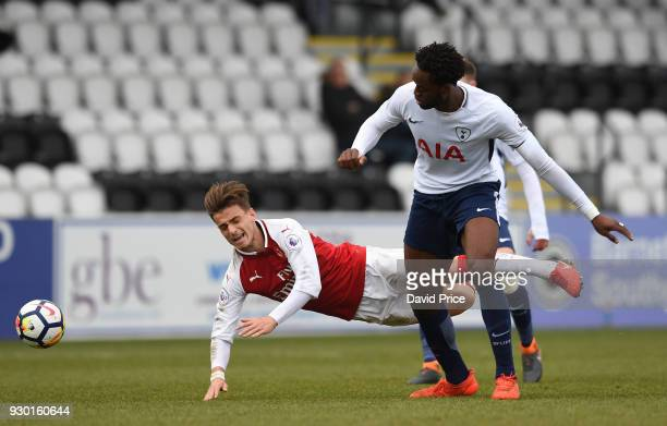 Vlad Dragomir of Arsenal is tripped by Christian Maghoma of Tottenham during the match between Arsenal and Tottenham Hotspur at Meadow Park on March...