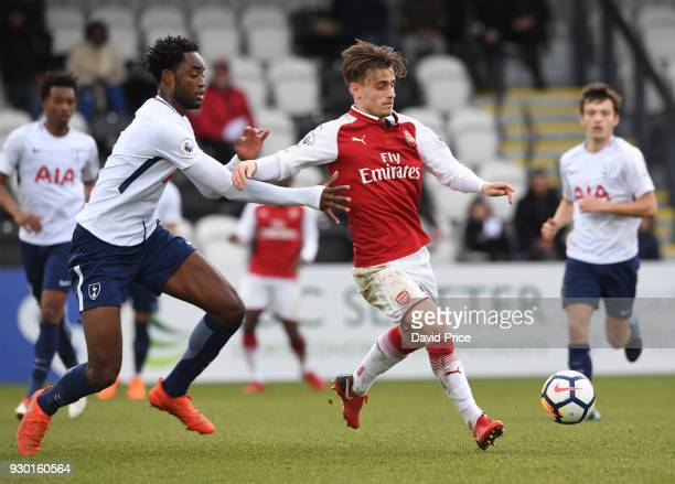 Vlad Dragomir of Arsenal passes the ball under pressure from Christian Maghoma of Tottenham during the match between Arsenal and Tottenham Hotspur at...