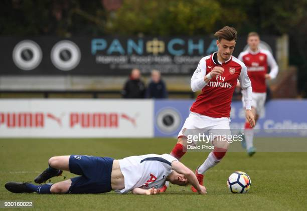 Vlad Dragomir of Arsenal rounds Oliver Skipp of Tottenham during the match between Arsenal and Tottenham Hotspur at Meadow Park on March 10 2018 in...