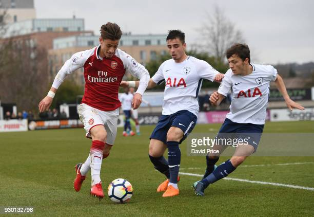 Vlad Dragomir of Arsenal takes on Anthony Georgiou and George Marsh of Tottenham during the match between Arsenal and Tottenham Hotspur at Meadow...
