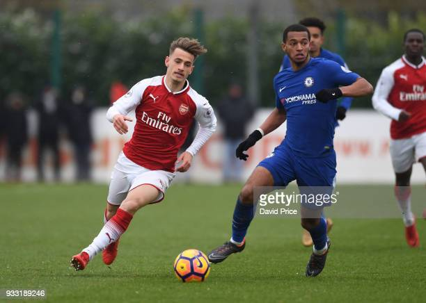 Vlad Dragomir of Arsenal takes on Josh Grant of Chelsea during the match between Arsenal U23 and Chelsea U23 at London Colney on March 17 2018 in St...