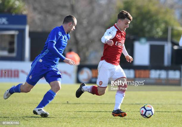 Vlad Dragomir of Arsenal takes on Marijan Cabraja of Dinamo during the match between Arsenal and Dinamo Zagreb at Meadow Park on February 24 2018 in...