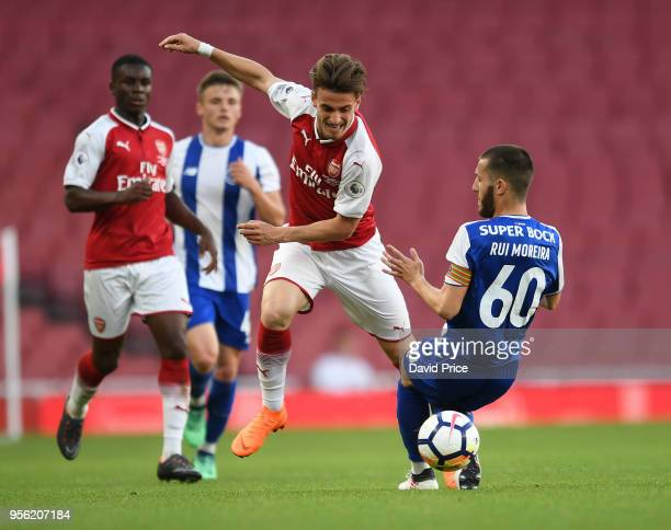 Vlad Dragomir of Arsenal takes on Rui Moreira of Porto during the match between Arsenal and FC Porto at Emirates Stadium on May 8 2018 in London...