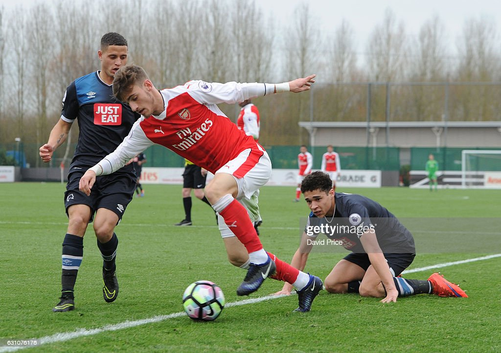 Vlad Dragomir of Arsenal trips under pressure from Alefe Santos of Derby during the match between Arsenal U23 and Derby County U23 at London Colney on January 6, 2017 in St Albans, England.