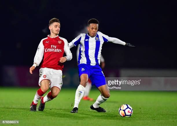 Vlad Dragomir of Arsenal U23s and Luiz Palhares of Porto U23s battle for possession during Premier League International Cup Group E match between...