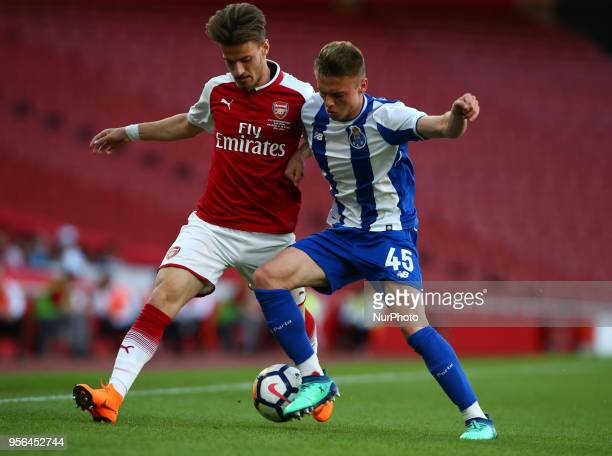 Vlad Dragomir of Arsenal U23s holds of Oleg Reabciuk of Porto FC during Premier League International Cup Final match between Arsenal Under 23 against...