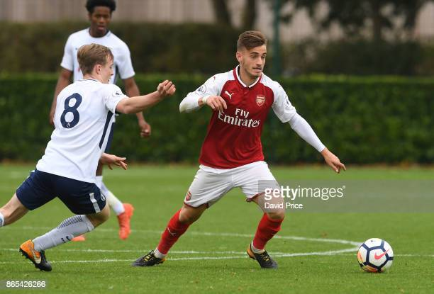 Vlad Dragomir of Arsenal under pressure from Oliver Skip of Tottenham during the match between Tottehma Hotspur and Arsenal on October 23 2017 in...