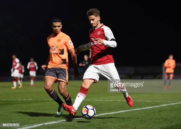 Vlad Dragomir of Arsenal under pressure from Tennia Watson of Reading during the Premier League International Cup match between Arsenal and Reading...