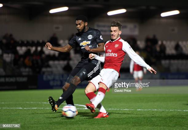 Vlad Dragomir scores Arsenal's 2nd goal under pressure from RoShaun Williams of Man Utd during the Premier League 2 match between Arsenal and...