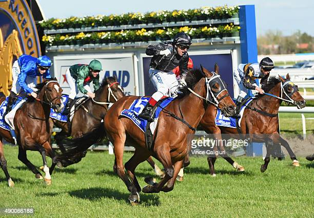 Vlad Duric riding Mourinho reacts after winning Race 7 the Underwood Stakes during Melbourne Racing at Caulfield Racecourse on September 26 2015 in...