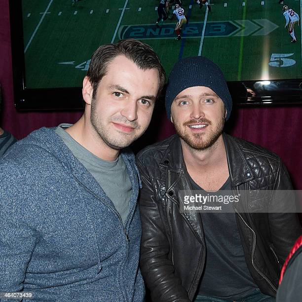Vlad Kazhdan and actor Aaron Paul attend Paige Hospitality Group's Third Annual Sundance Football Game Watch on January 19 2014 in Park City Utah