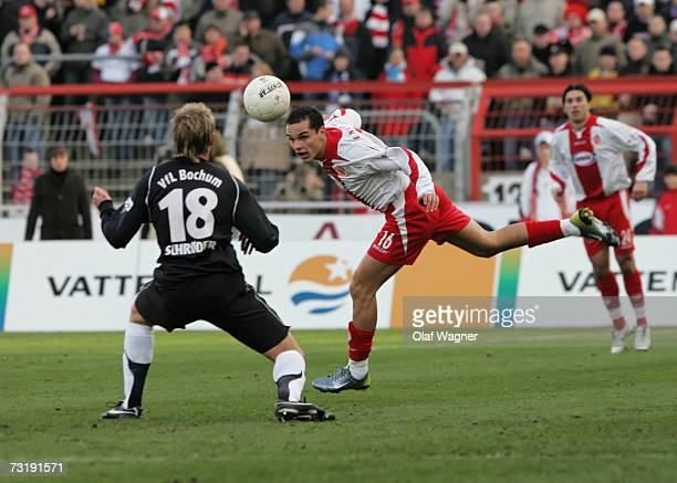 Vlad Munteanu of Cottbus battle for the ball with Oliver Schrder of Bochum during the Bundesliga match between Energie Cottbus and VFL Bochum at the...