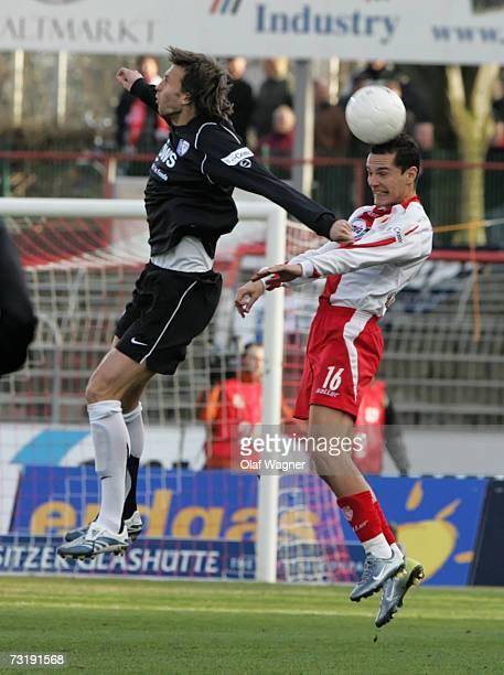 Vlad Munteanu of Cottbus goes up for the ball with Christoph Dabrowski of Bochumduring the Bundesliga match between Energie Cottbus and VFL Bochum at...
