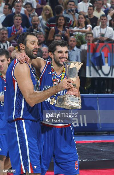 Vlade Divac and Predrag Stojakovic of Yugoslavia celebrate with the World Championship trophy after defeating Argentina in the Gold medal game of the...