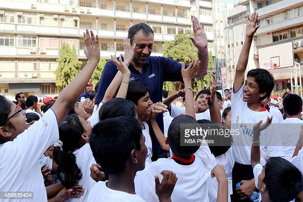 Vlade Divac high fives young fans during a clinic at the Reliance Foundation Jr NBA Youth Program at IES VN Sule Guruji School in Mumbai India on...