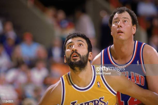 Vlade Divac of the Los Angeles Lakers boxes out Paul Mokeski of the Cleveland Cavaliers during an NBA game at the Great Western Forum in Los Angeles...