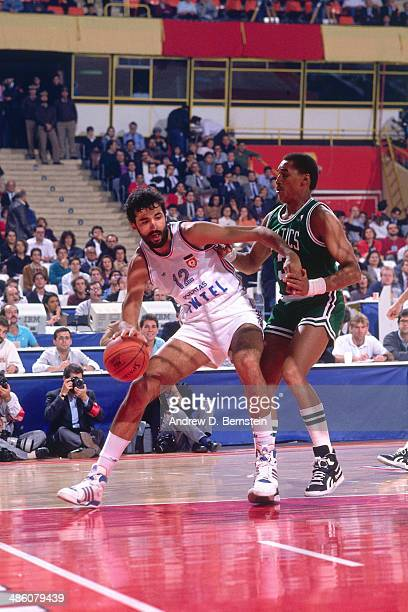 Vlade Divac of the Yugoslavia drives against the Dennis Johnson of the Boston Celtics during the 1988 McDonald's Championships on October 21 1988 at...