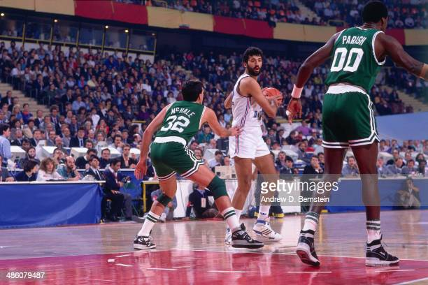 Vlade Divac of Yugoslavia drives against Kevin McHale of the Boston Celtics during the 1988 McDonald's Championships on October 21 1988 at the...