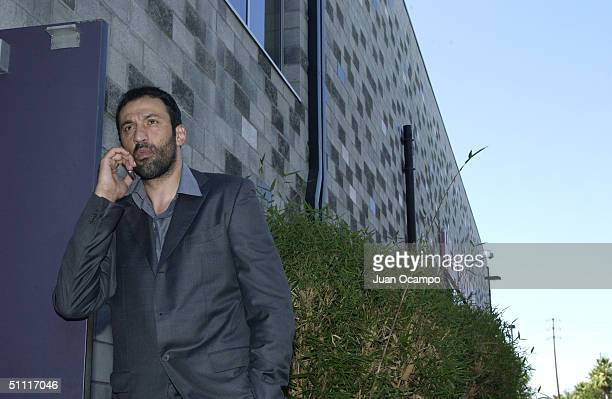 Vlade Divac uses his cell phone outside after a press conference to announce his signing to a freeagent contract with the Los Angeles Lakers on July...