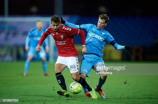 Vladen Yurchenko of Vejle Boldklub and Nicolai Poulsen of Randers FC compete for the ball during the Danish Superliga match between Randers FC and...
