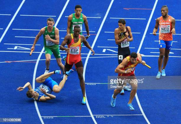 Vladimir Aceti of Italy collides with Darwin Andres Echeverry of Spain during the hand over of the baton during the Men's 4 x 400m Relay...