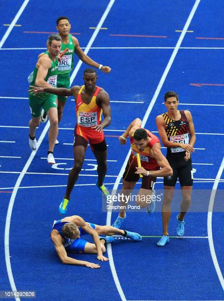 Vladimir Aceti of Italy collides with Samuel Garcia of Spain during the hand over of the baton during the Men's 4 x 400m Relay qualification during...