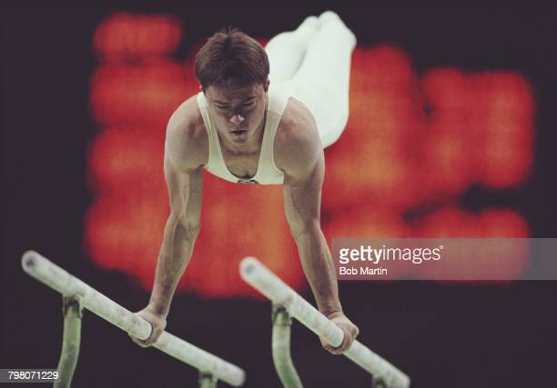 Vladimir Artemov of the Soviet Union performs during the Men's Parallel Bars on 24 September 1988 during the XXIV Summer Olympic Games at the Olympic...