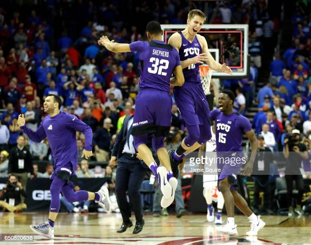 Vladimir Brodziansky and Karviar Shepherd of the TCU Horned Frogs celebrate as the Horned Frogs defeat the Kansas Jayhawks 8582 to win the...