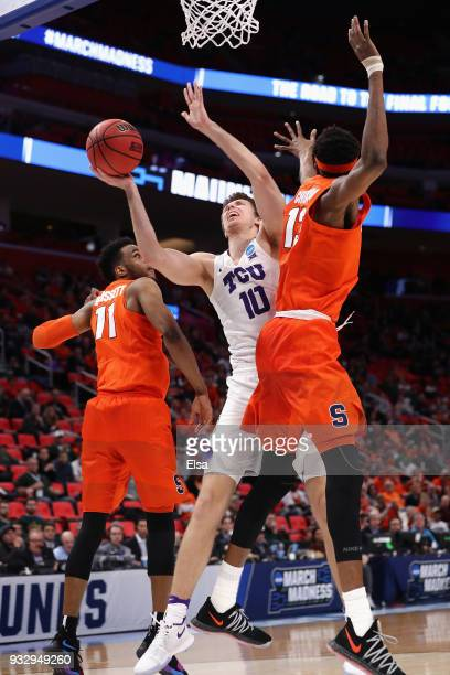 Vladimir Brodziansky of the TCU Horned Frogs drives to the basket against Oshae Brissett and Paschal Chukwu of the Syracuse Orange during the second...