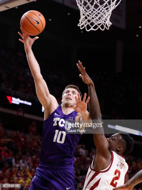 Vladimir Brodziansky of the TCU Horned Frogs lays up a shot as Cameron Lard of the Iowa State Cyclones defends in the second half of play at Hilton...