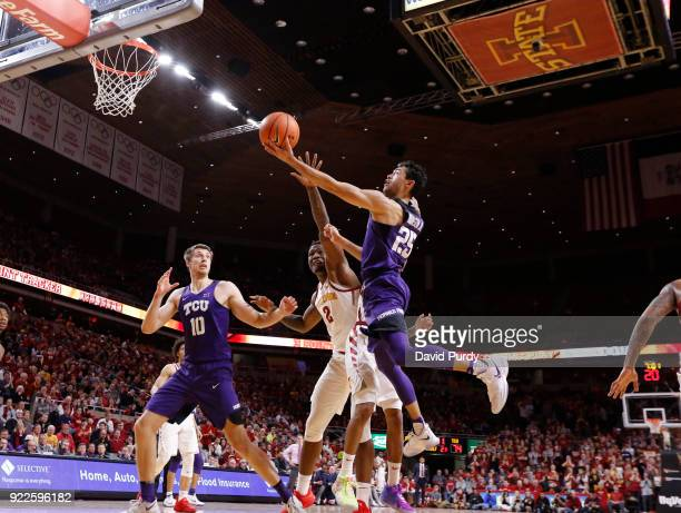 Vladimir Brodziansky of the TCU Horned Frogs watches on as teammate Alex Robinson lays up a shot agaisnt Cameron Lard of the Iowa State Cyclones...