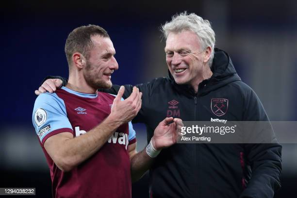 Vladimir Coufal of West Ham United and David Moyes, Manager of West Ham United react following victory during the Premier League match between...