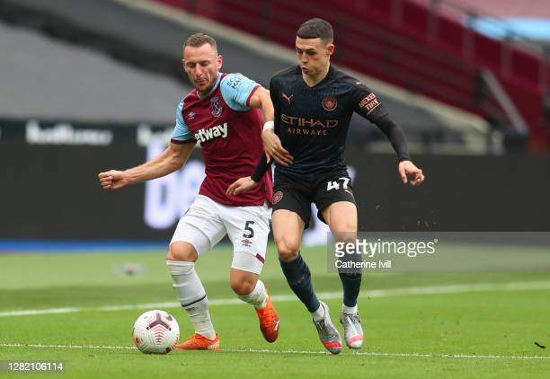Vladimir Coufal of West Ham United and Phil Foden of Manchester City during the Premier League match between West Ham United and Manchester City at...