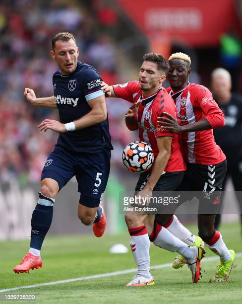 Vladimir Coufal of West Ham United breaks past Romain Perraud and Moussa Djenepo of Southampton United during the Premier League match between...