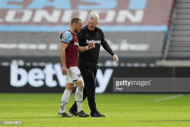 Vladimir Coufal of West Ham United interacts with David Moyes, Manager of West Ham United following the Premier League match between West Ham United...