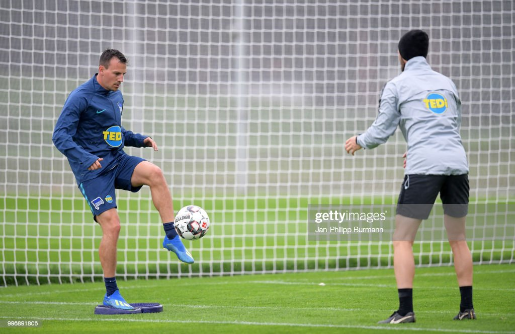 Vladimir Darida and athletic trainer Hendrik Vieth of Hertha BSC during the training at the Schenkendorfplatz on July 12, 2018 in Berlin, Germany.