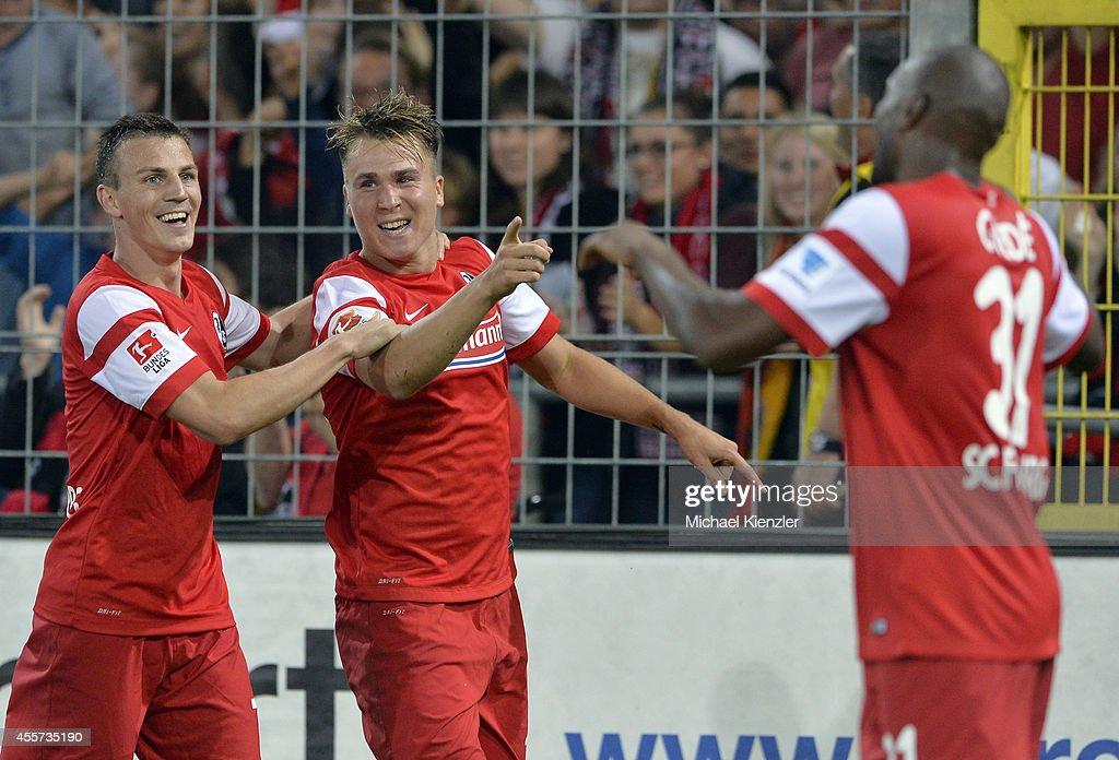 Vladimir Darida, Felix Klaus and Karim Guede (L-R) of Freiburg celebrates goal of Felix Klaus during the Bundesliga match between SC Freiburg and Hertha BSC at Mage Solar Stadium on September 19, 2014 in Freiburg, Germany.
