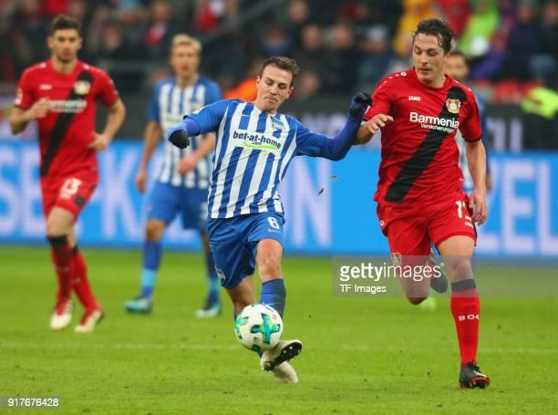 Vladimir Darida of Berlin and Julian Baumgartlinger of Leverkusen battle for the ball during the Bundesliga match between Bayer 04 Leverkusen and...