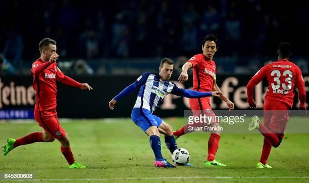 Vladimir Darida of Berlin and Makoto Hasebe of Frankfurt battle for the ball during the Bundesliga match between Hertha BSC and Eintracht Frankfurt...