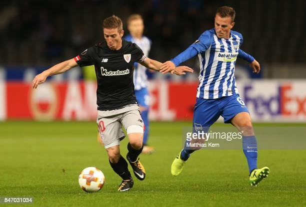Vladimir Darida of Berlin battles for the ball with Iker Muniain of Bilbao during the UEFA Europa League group J match between Hertha BSC and...