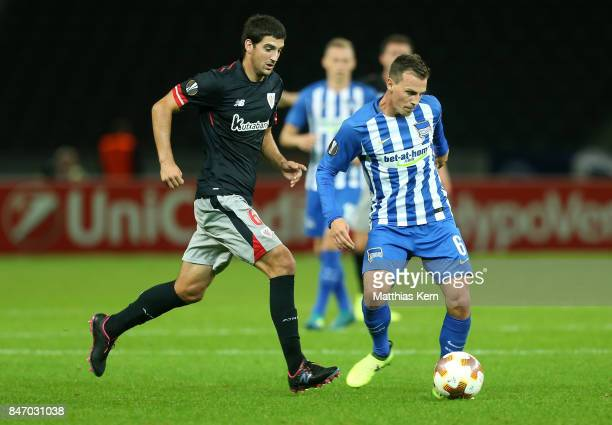 Vladimir Darida of Berlin battles for the ball with Mikel San Jose of Bilbao during the UEFA Europa League group J match between Hertha BSC and...