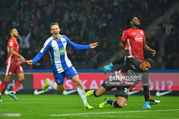 Vladimir Darida of Berlin celebrates scoring his teams third goal against goalkeeper Zack Steffen during the Bundesliga match between Hertha BSC and...