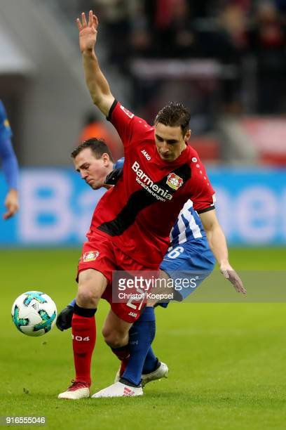 Vladimir Darida of Berlin challenges Dominik Kohr of Leverkusen during the Bundesliga match between Bayer 04 Leverkusen and Hertha BSC at BayArena on...