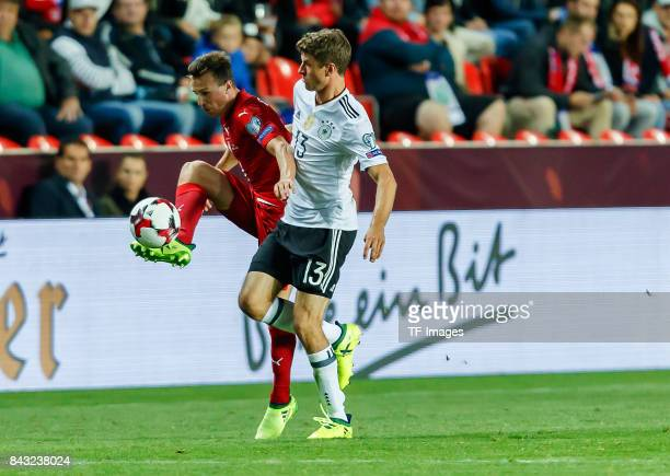 Vladimir Darida of Czech Republic und Thomas Mueller of Germany battle for the ball during the FIFA 2018 World Cup Qualifier between Czech Republic...