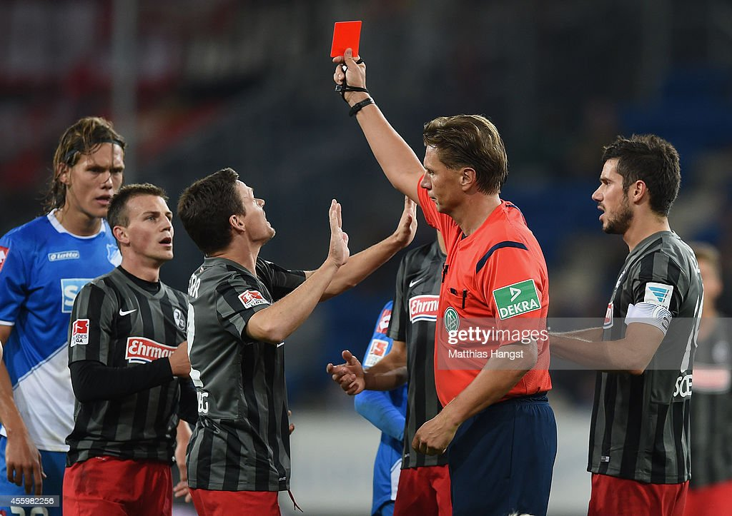 Vladimir Darida (2 R) of Freiburg is shown a red card by referee Thorsten Kinhoefer during the Bundesliga match between TSG 1899 Hoffenheim and SC Freiburg at Wirsol Rhein-Neckar-Arena on September 23, 2014 in Sinsheim, Germany.