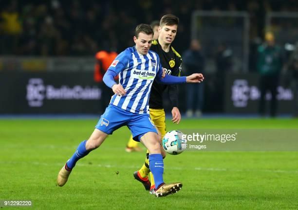 Vladimir Darida of Hertha and Julian Weigl of Dortmund battle for the ball during the Bundesliga match between Hertha BSC and Borussia Dortmund at...