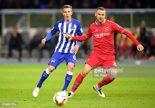 Vladimir Darida of Hertha BSC and Alexander Milosevic of Hannover 96 during the game between Hertha BSC and Hannover 96 on april 8 2016 in Berlin...