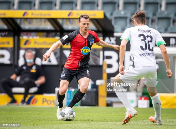 Vladimir Darida of Hertha BSC and Florian Neuhaus of Borussia Moenchengladbach during the Bundesliga match between Borussia Moenchengladbach and...
