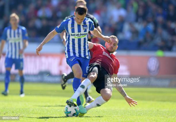 Vladimir Darida of Hertha BSC and Marvin Bakalorz of Hannover 96 during the Bundesliga game between Hannover 96 and Hertha BSC at HDI Arena on May 5...